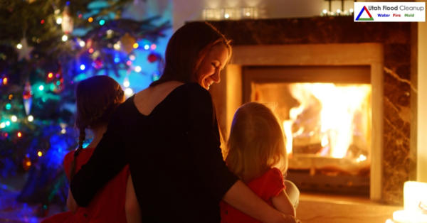 Lady with her Children near a Christmas Tree and Fire place