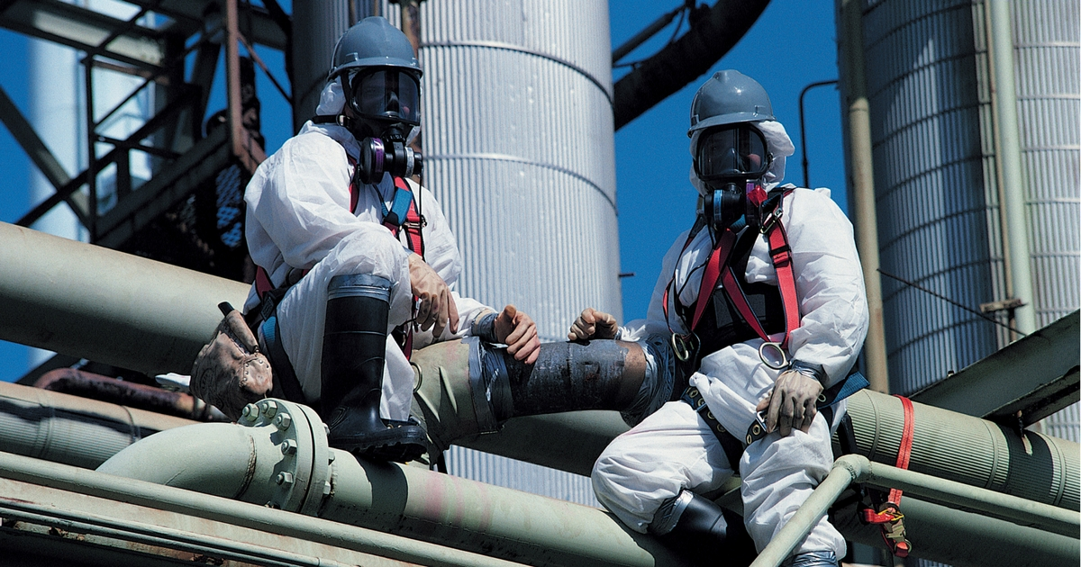 men in protective suits - Commercial Asbestos abatement in Utah