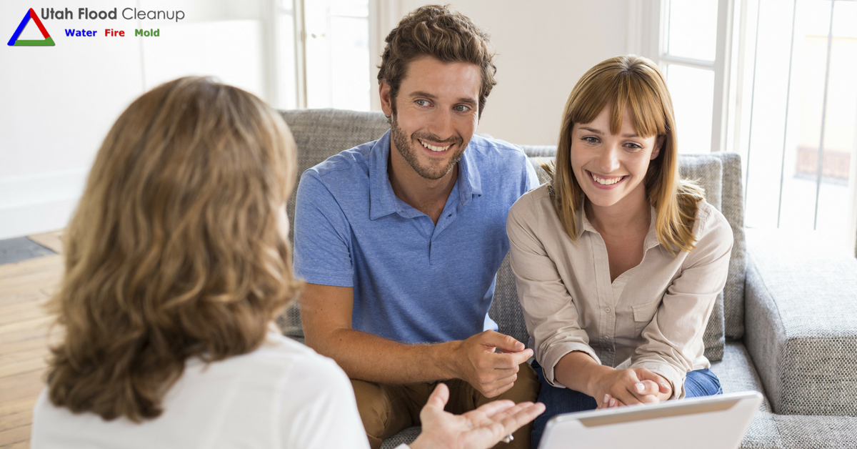 Happy couple talking with a woman - Avoid Disaster with these tips for new homeowners