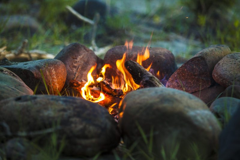 Tourist Bonfire at Dusk in The Forest - Fire Safety and prevention Tips in Utah - Utah Flood Cleanup Stay Safe Around the Campfire This Summer Tourist bonfire at dusk in the forest 800x533