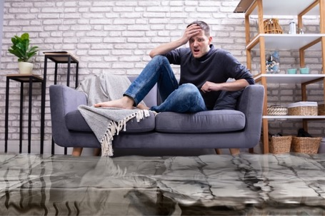 Water Flooding in a Room- Man Sitting on a Couch