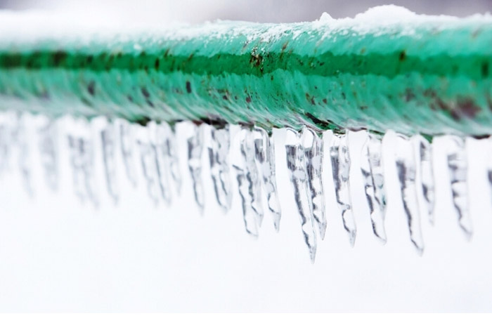 Ice on a water pipe -  fast, affordable solutions for water damage caused by frozen pipes