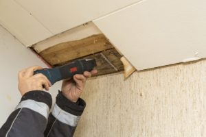 Testing a ceiling for Mold - Mold Testing Services in Utah - Utah Flood Cleanup